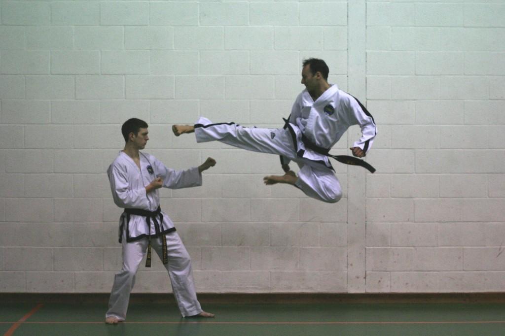 Master Dennis Flying Side Kick